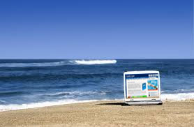 enter sweepstakes on the beach with your laptop