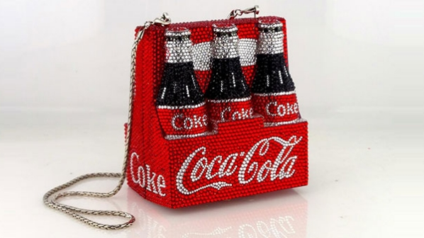 Here's your chance to win an exclusive Kathrine Baumann Coca-Cola Bottle Purse dazzled with thousands of Swarovski crystals. Each purse is between $2,900 and $3,400 and will be a true collector's item for years to come.