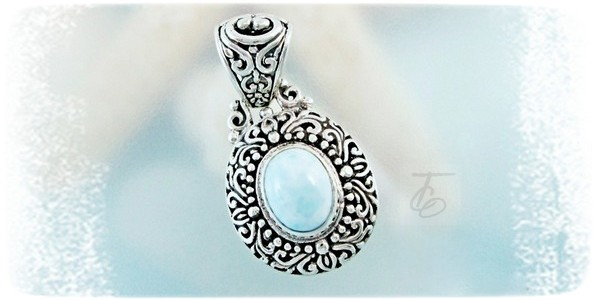 "Enter for your chance to win a .925 Sterling Silver, filigree styled pendant shows off a large baby blue, oval 10.5-x-8.5 x 6-mm bezel set Larimar gemstone. TGW- 3.25 Carats. Pendant measures 1-1/4"" length from top of bail. 5/8"" wide."